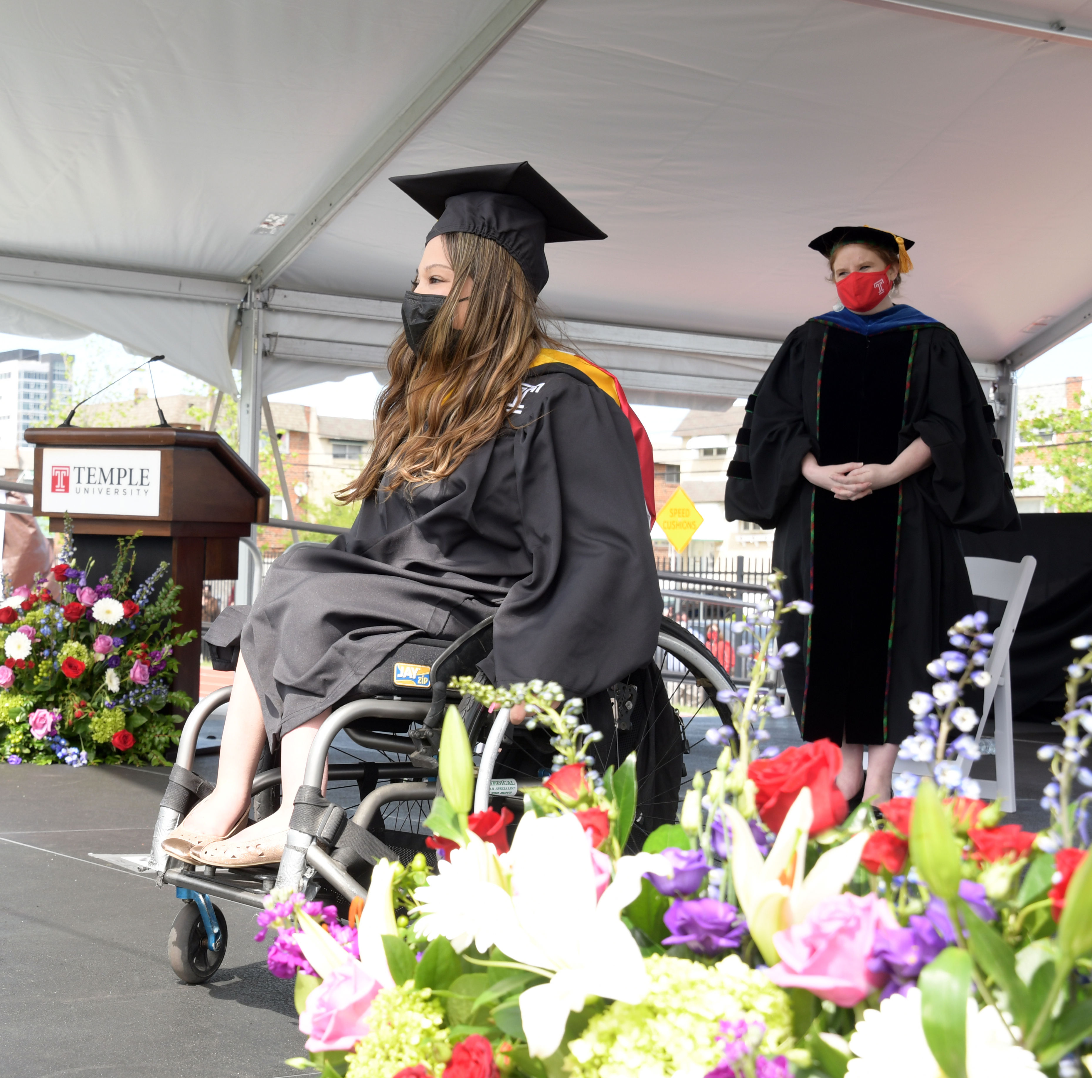 graduate is honored on stage