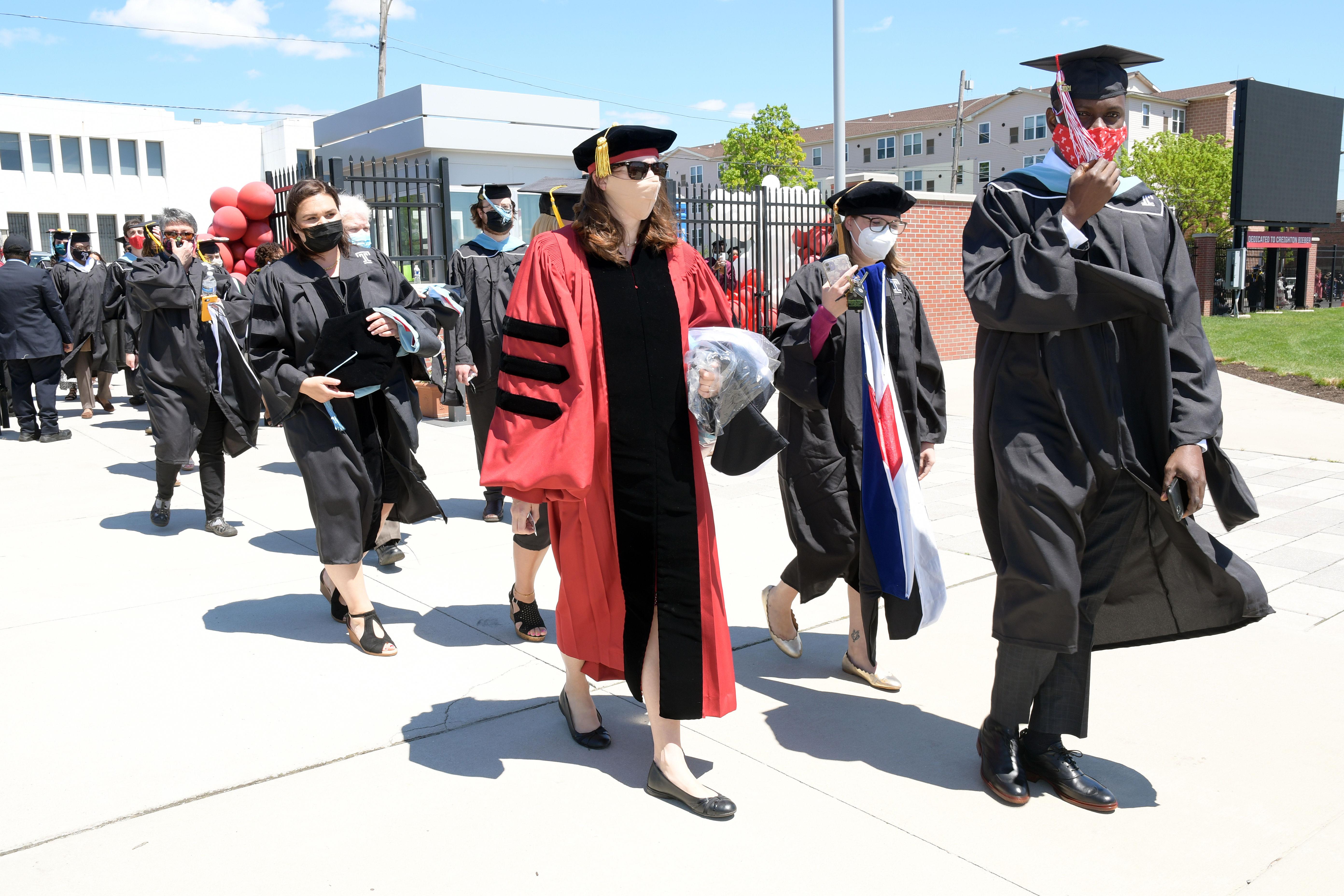 graduates walk into ceremony