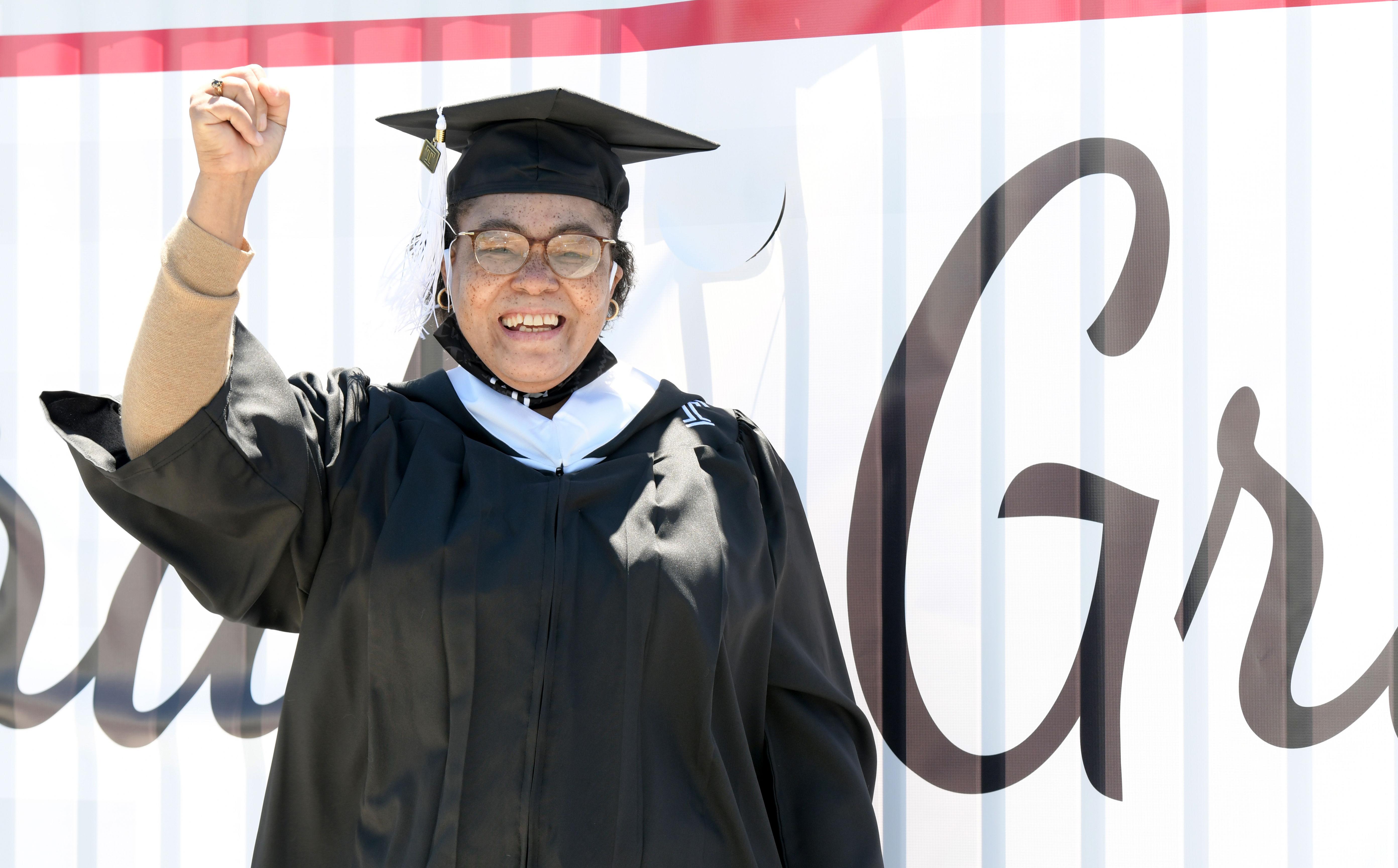 Graduate celebrates outside ceremony