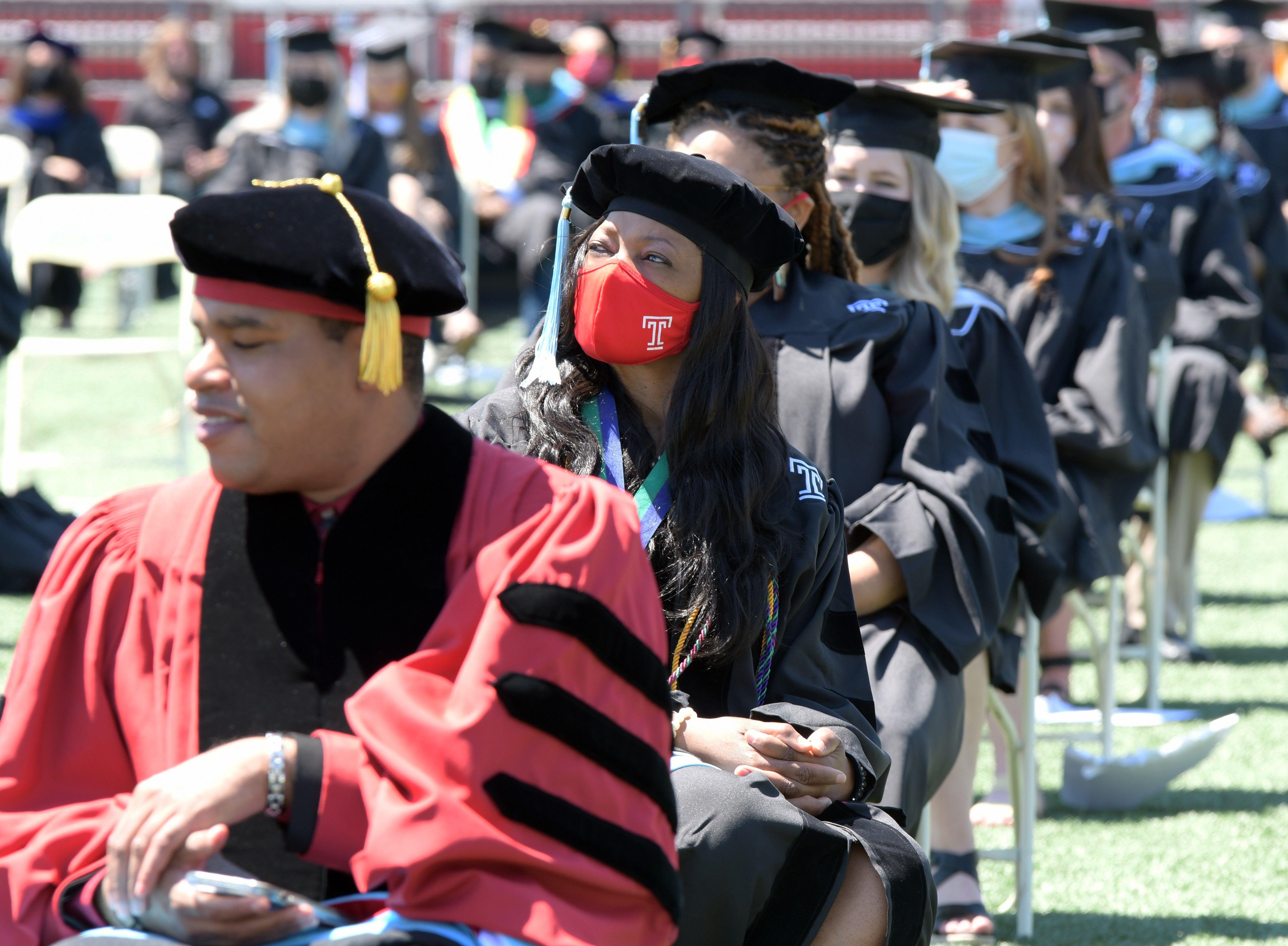 graduates sit during ceremony