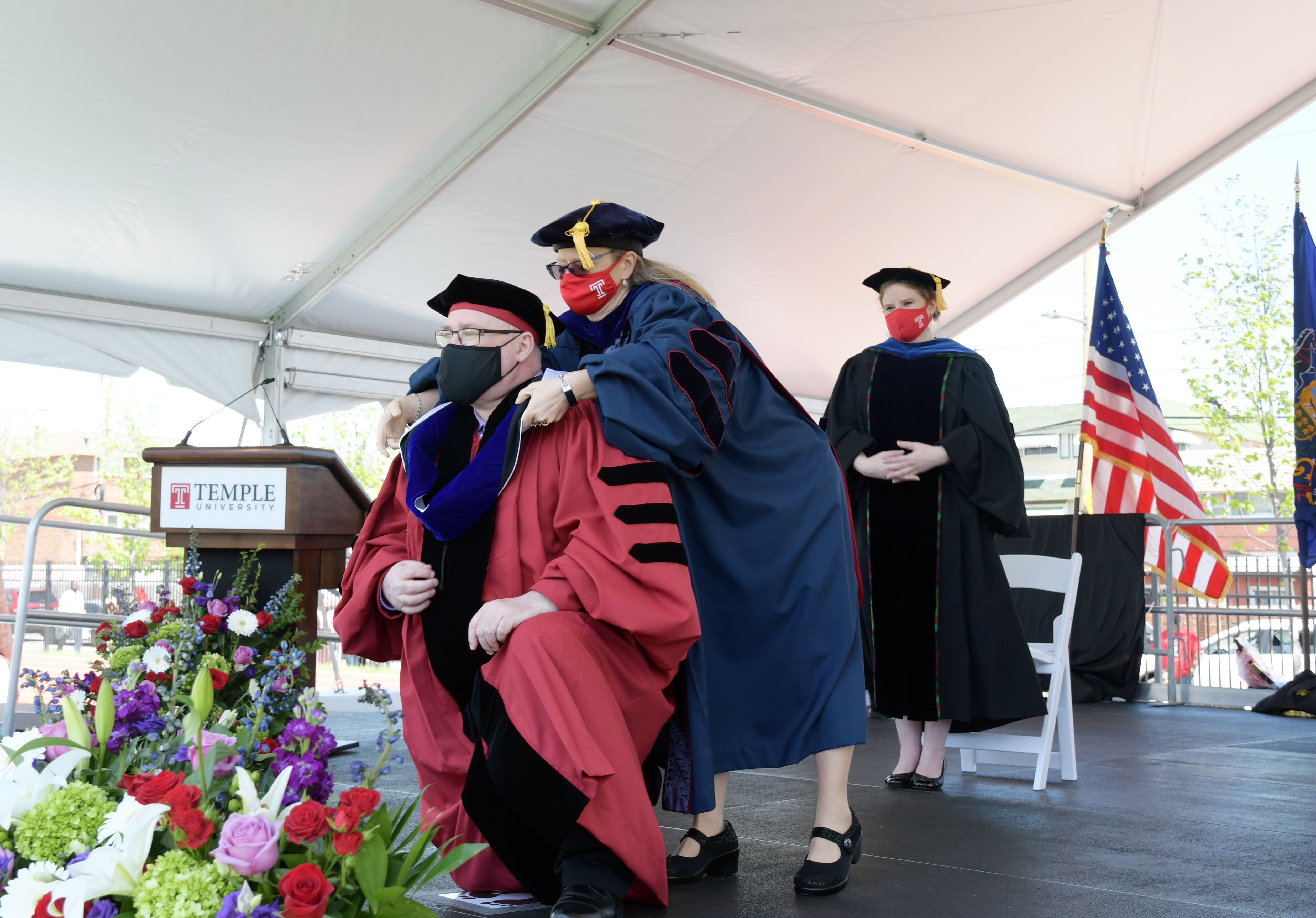 doctoral candidate is hooded by faculty member