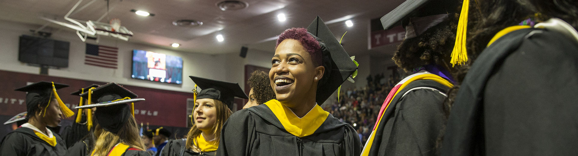 Temple graduates in cap and gown