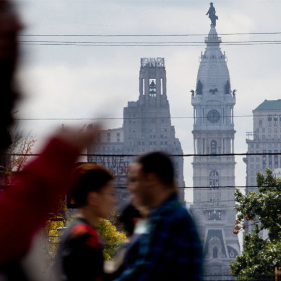 Temple students walking in front of Philadelphia skyline